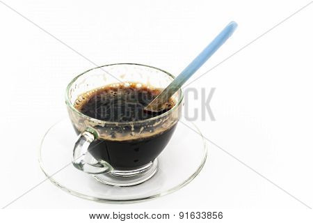 Dirty Black Coffee With Spoon