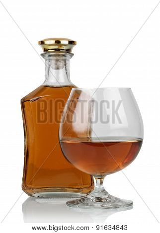 Glass of cognac with bottle