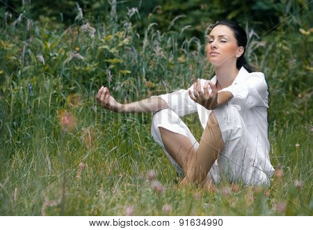 Meditation. Young Beautiful Woman Meditating In A Nature, Outdoors. Healthy Lifestyle. Attractive Fe