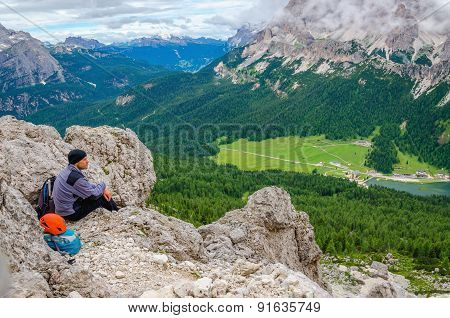 Climber in Dolomites Mountains, Italy