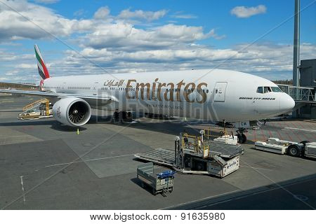 OSLO, NORWAY - MAY 3, 2015: Emirates Boeing 777-300ER ready for boarding at Oslo Gardermoen airport.