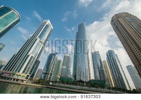Tall skyscrapers in Dubai near water