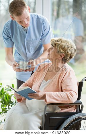 Nurse And Woman On A Wheelchair