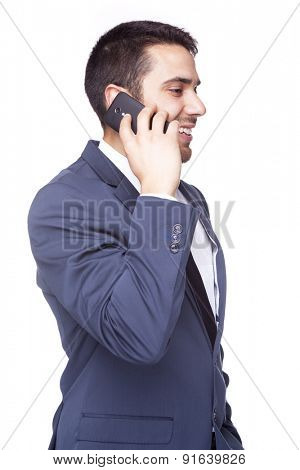 Side view of a smiling business man talking on the cell phone, isolated on white background
