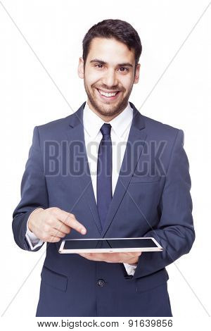 Smiling business man pointing to a tablet computer, isolated on white background
