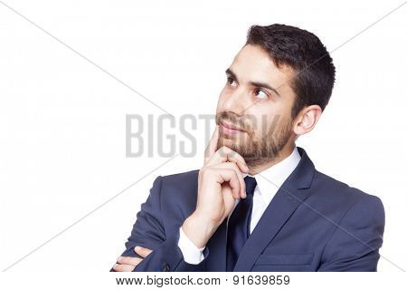 Serious businessman thinking, isolated on a white background