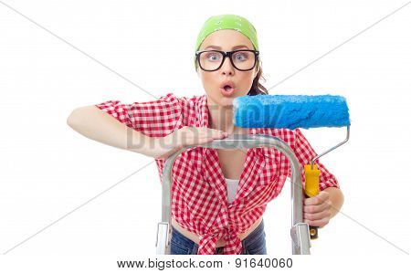 Astonished Woman With Roller Ready For Wall Painting Or New Home Renovating, Isolated On White