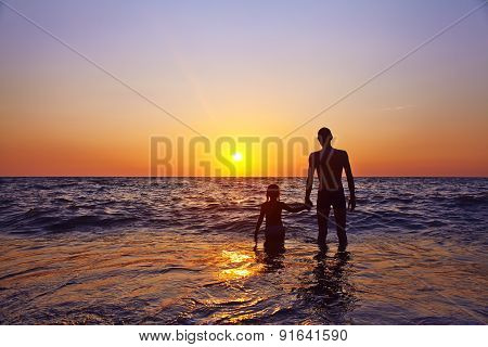 father and daughter at sunset