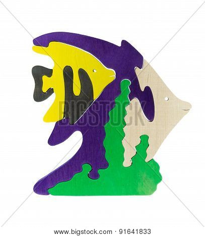 Colorful wooden puzzle in fishes shape on isolated background