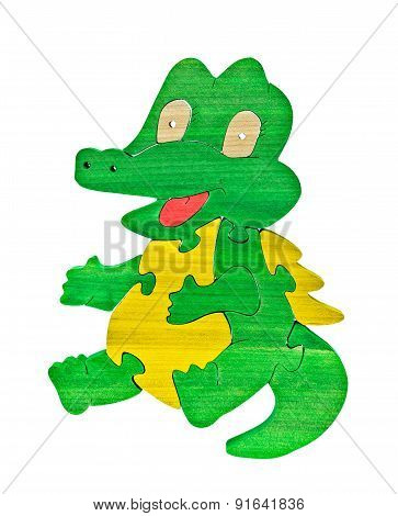 Colorful wooden puzzle in crocodile shape on isolated background