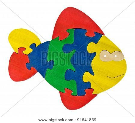 Colorful wooden puzzle in fish shape on isolated background