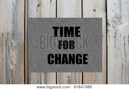 Time for change text on wooden background