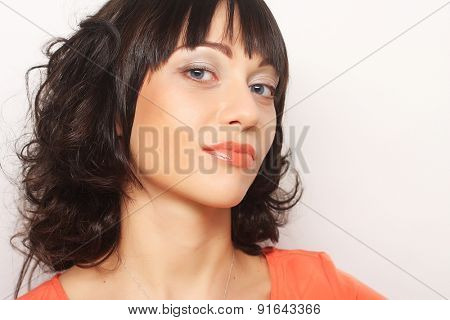 Beautiful young surprised woman. Studio shot.