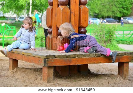 Happy Little Girls  At Playground In Sunny Day