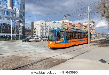 Tram Rides On Street In Summer Sunny Day