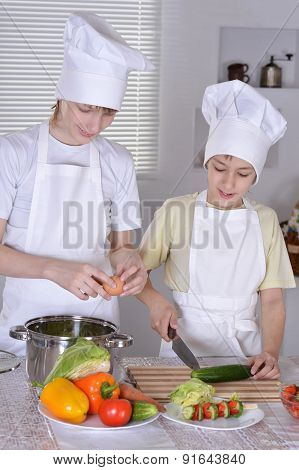 two cooks in the kitchen preparing