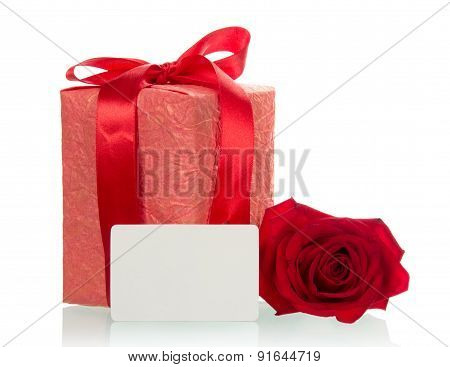Red rose with holiday gift