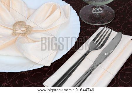 The golden heart napkin ring on plate