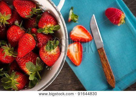 Fresh Just Clean Wet Strawberries In Rustic Colander
