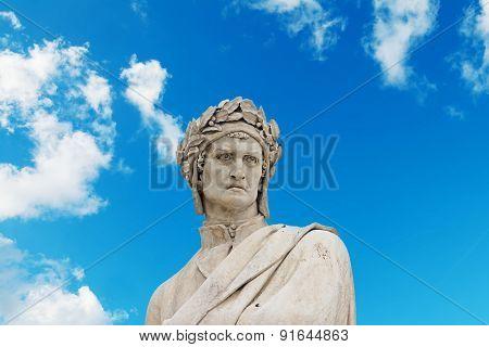 Alighieri Statue Under A Blue Sky With Clouds