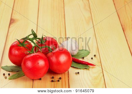 Tomatoes and spices on table