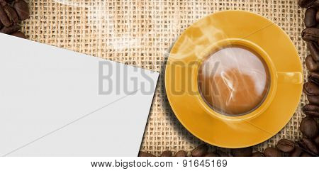 Yellow cup of coffee against white card