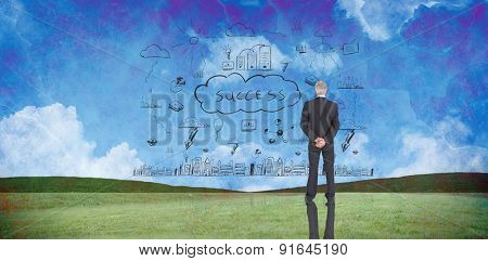 Businessman standing against painted country scene