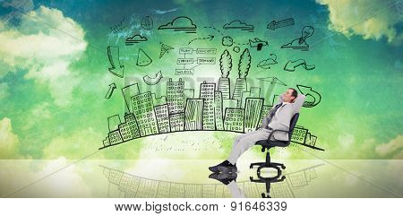 Businessman relaxing in swivel chair against blue and green sky