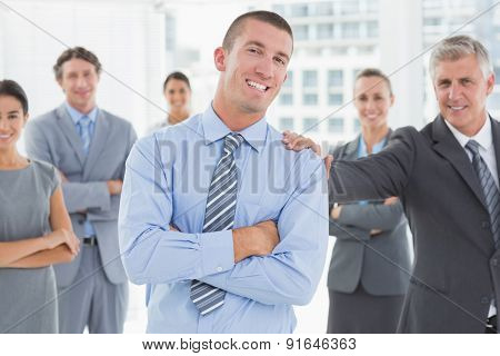 Smiling business team standing with arms crossed in the office