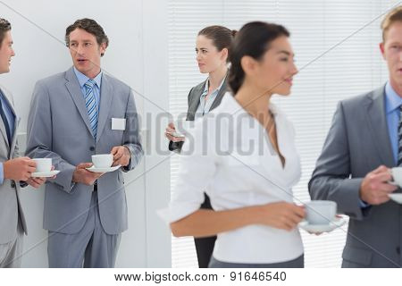 Business people drinking cup of coffee in the meeting room