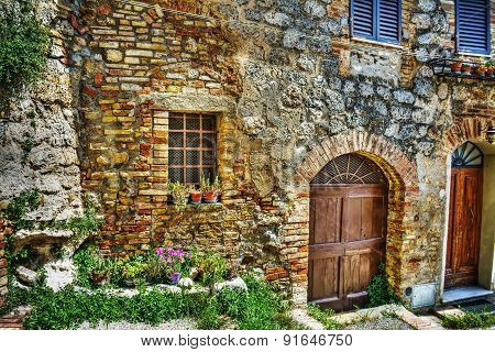 Brick Wall And Wooden Doors