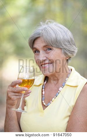 Old woman drinking wine