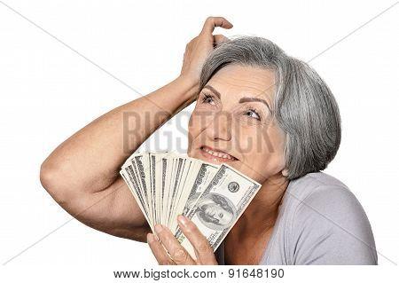 Happy elderly woman with dollars