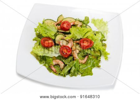 Caesar salad with shrimps isolated on white background.