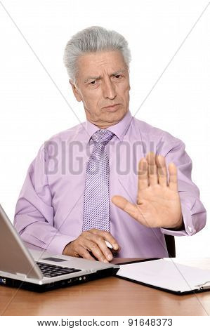 Old businessman working with notebook isolated