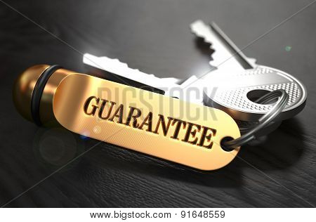 Guarantee - Bunch of Keys with Text on Golden Keychain.
