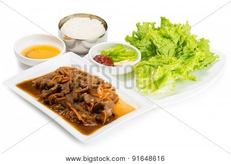 Stir-fried pork with carrots, onions and rice. From a series of Food Korean cuisine.