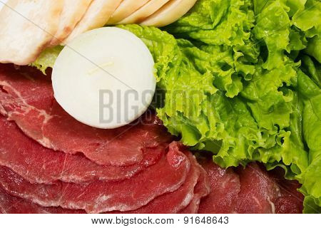 Raw fresh thinly sliced meat with lettuce, mushrooms, onions for grilling. From a series of Food Korean cuisine.