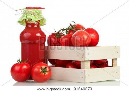 Tomatoes in crate andTomato juice