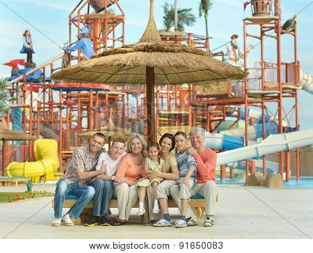 Family relaxing at vacation resort