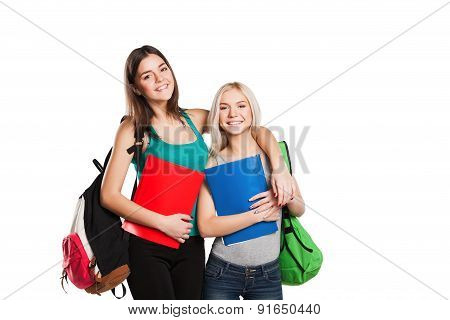 Two students with school bags posing isolated on white background