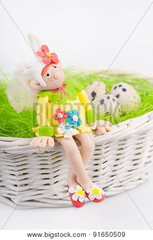 Dreamed fairy on the nest with quail eggs