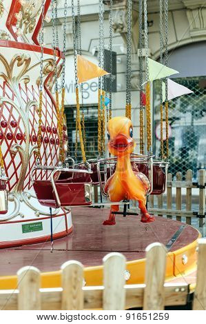 Duck Toy In The Seat Of A Colorful Merry Go Round