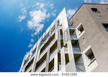 Aluminum Concrete Facade And Aluminum Panels Against Blue Clear Sky
