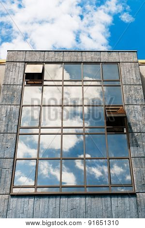 Glass Facade With Clouds Reflections