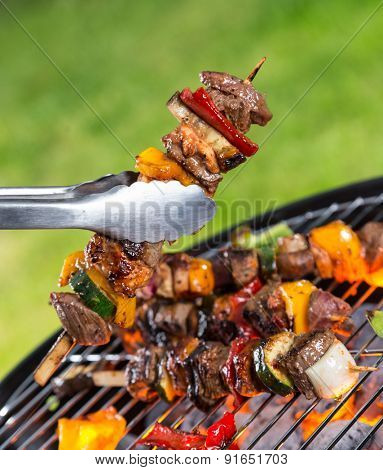 Delicious vegetable and meat skewer on grill