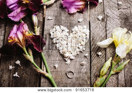 Heart Shape Of White Lilac Flowers And Ring On Wood Table