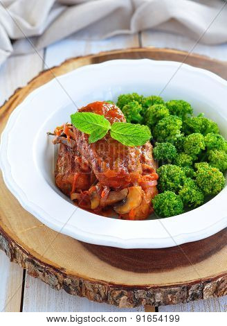 Fried meat cutlets with tomato sauce and broccoli