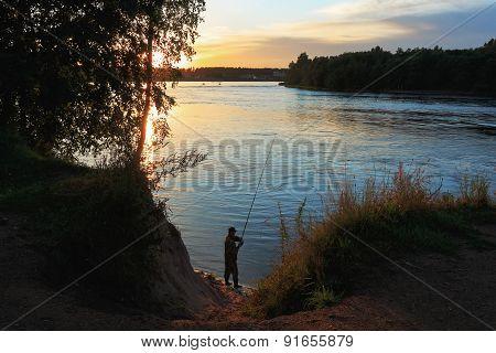 Fisherman At Sunseat
