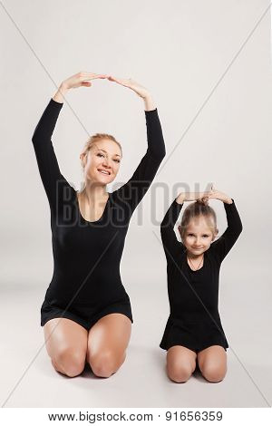 mother and daughter are gymnastics